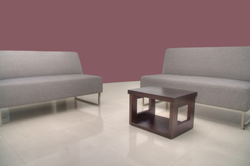 Sofas with coffee table with Maroon Wall background