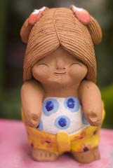 Clay dolls in thai children form for decoration