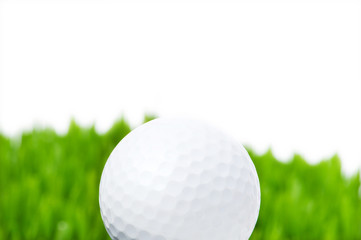 Golf ball and grass isolated on the white background