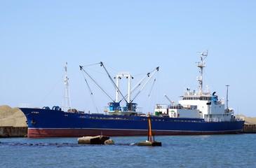 fishing ship beside quay.