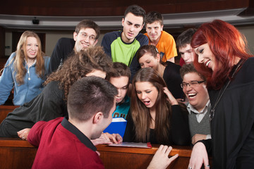 Group of students laughing in classroom