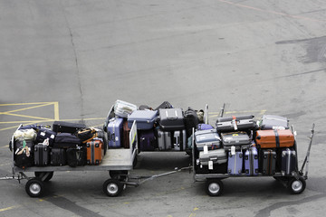 Ballet of baggage carts on an airport