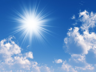 beams of the sun and clouds in the blue sky