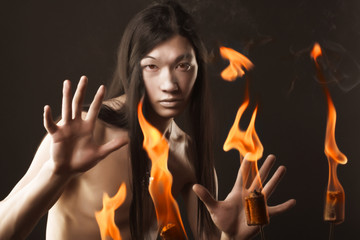 Portrait of asian man with fire