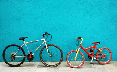 Two basycles against blue wall