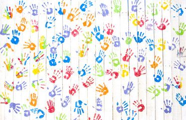 Colorful handprints on a wall