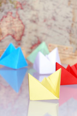 Paper Boats On Background With Map