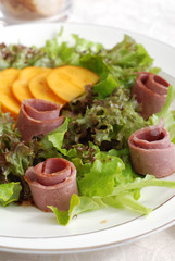 Mixed salad leaves with persimmon and smoked duck breast