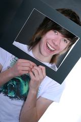 Teenage Boy Framing Face with Picture Frame