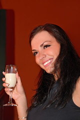 beautiful girl with glass of drink