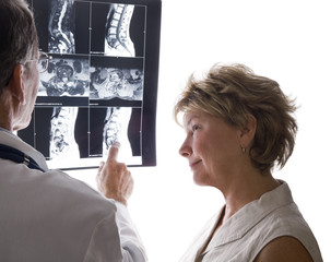 Doctor and Patient Reviewing MRI, Xray Scans