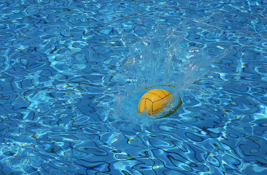 Yellow water polo ball on blue water background
