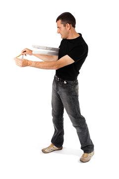 Man measuring the white walll