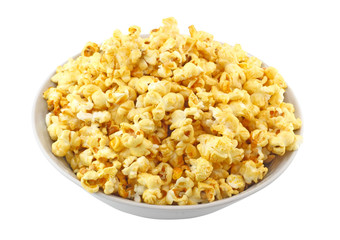 Bowl full of caramel popcorn isolated on white background
