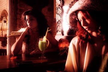 couple of elegant women in cafe