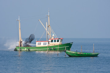 Fishing ship cleaning the nets with water jet