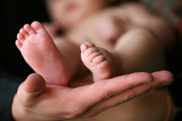 Father holding his child's feet