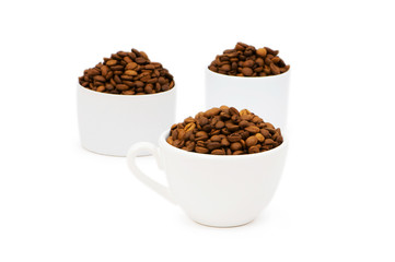Cup and coffee beans isolated on the white