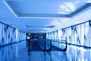 Person move in blue corridor