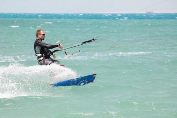 Kiteboarder surfing