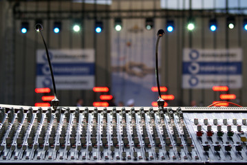 Sound mixer in a concert hall