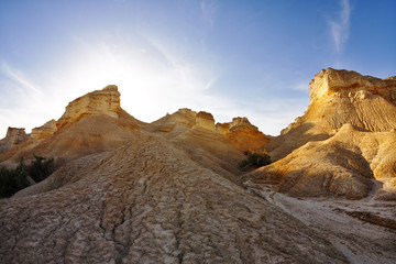 Ancient mountains in desert on a sunset