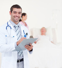 Doctors looking after a senior patient