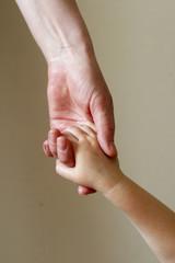 mother and child handshake