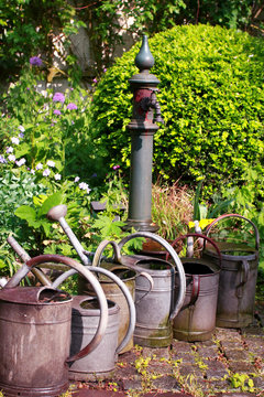 Still life in a german garden, old watering cans
