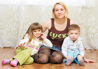 mother with son and daughter on a floor