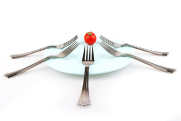 forks and tomat on dish