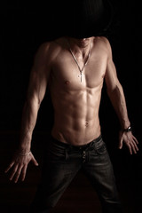 sexual young macho with a beautiful body of athlete in a black h