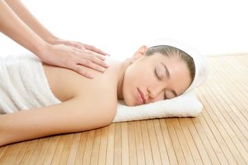 Beautiful woman on spa massage on back