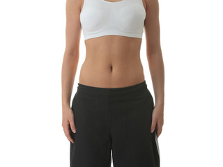 Midsection of a physically fit young woman