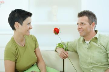 Man giving red rose