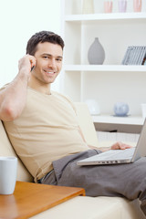 Young man teleworking from home