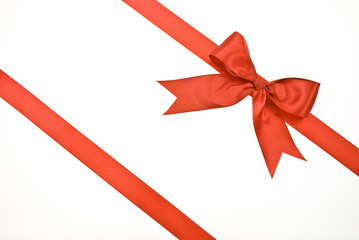 Gift packaging with red ribbons and bow isolated on white