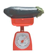 Kitchen scale weighting eggplant