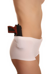 a woman in white panties with a gun