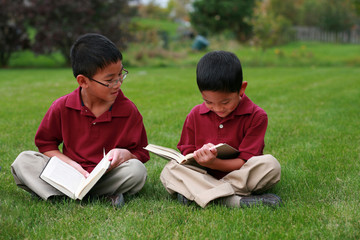 Asian boys reading