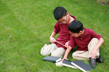 asian boys with ruler and books