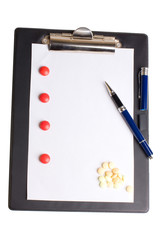 Pills and notepad