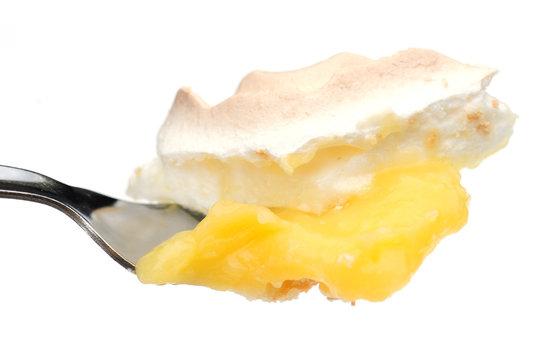 fork full of lemon meringue pie