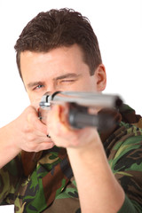 man in camouflage  pointed from gun