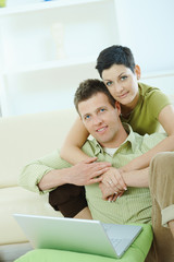 Love couple using laptop