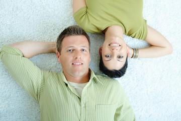 Couple lying on floor