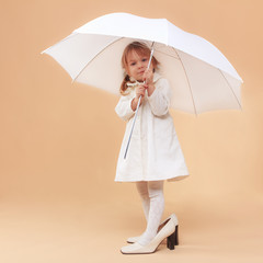 Funny child with umbrella