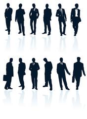 Set of dark blue vector businessman silhouettes.