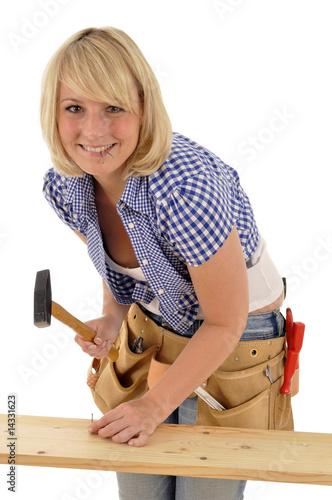 handwerkerin mit hammer und n geln stockfotos und lizenzfreie bilder auf bild. Black Bedroom Furniture Sets. Home Design Ideas