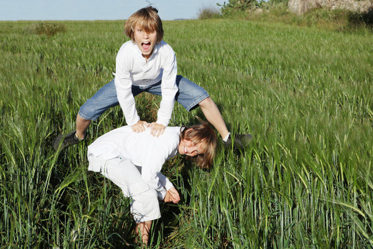 kids playing leapfrog in summer